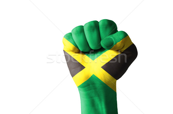 Fist painted in colors of jamaica flag Stock photo © vepar5
