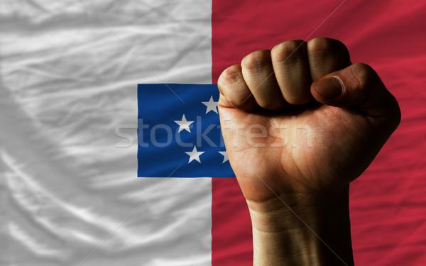 Hard fist in front of franceville flag symbolizing power Stock photo © vepar5