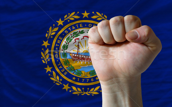 us state flag of new hampshire with hard fist in front of it sym Stock photo © vepar5