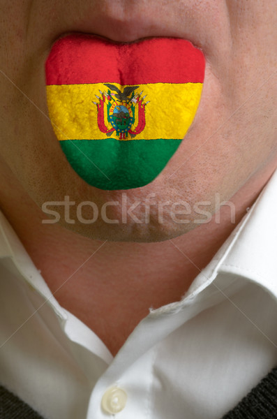 man tongue painted in bolivia flag symbolizing to knowledge to s Stock photo © vepar5