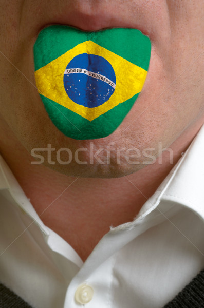 man tongue painted in brazil flag symbolizing to knowledge to sp Stock photo © vepar5
