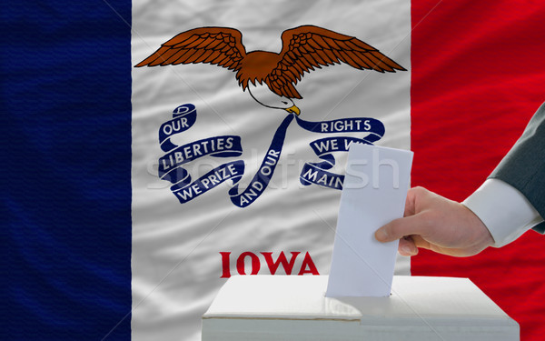 man voting on elections in front of flag US state flag of iowa Stock photo © vepar5