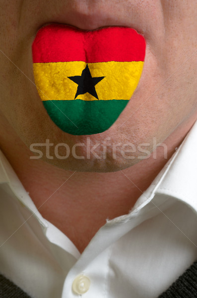 man tongue painted in ghana flag symbolizing to knowledge to spe Stock photo © vepar5