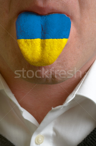 man tongue painted in ukraine flag symbolizing to knowledge to s Stock photo © vepar5