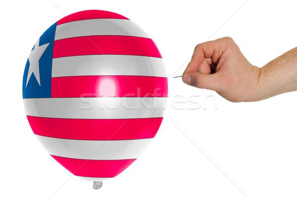 Bursting balloon colored in  national flag of liberia    Stock photo © vepar5
