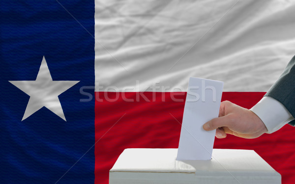 man voting on elections in front of flag US state flag of texas Stock photo © vepar5