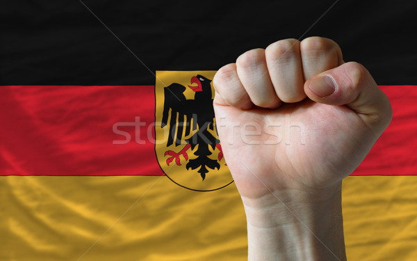 Hard fist in front of germany flag symbolizing power Stock photo © vepar5