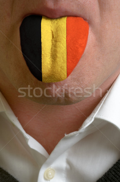 man tongue painted in belgium flag symbolizing to knowledge to s Stock photo © vepar5