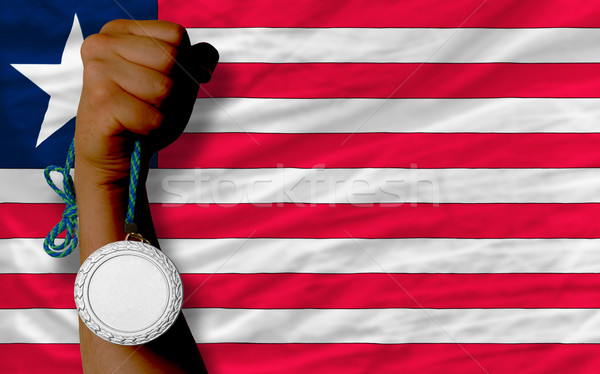 Silver medal for sport and  national flag of liberia    Stock photo © vepar5