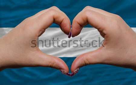 Heart and love gesture showed by hands over flag of Armenia back Stock photo © vepar5