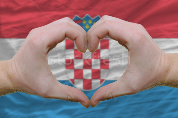 Heart and love gesture showed by hands over flag of Croatia back Stock photo © vepar5