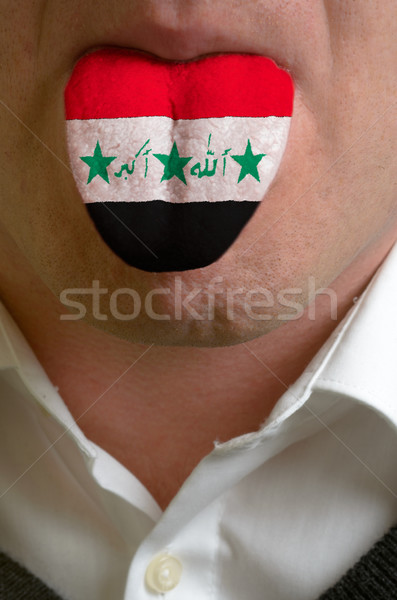 man tongue painted in iraq flag symbolizing to knowledge to spea Stock photo © vepar5