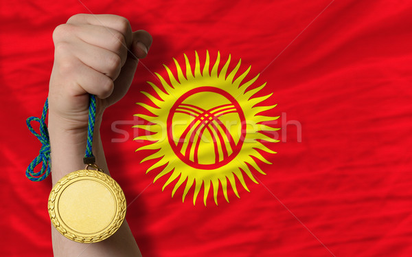 Stock photo: Gold medal for sport and  national flag of kirghizstan