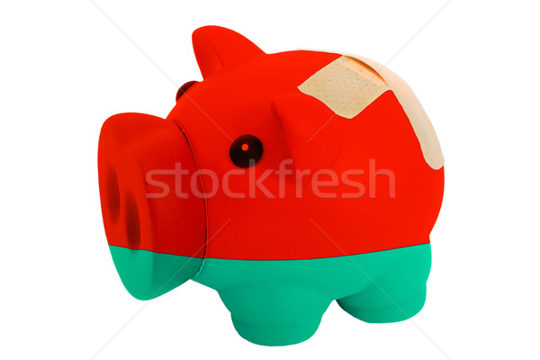 closed piggy rich bank with bandage in colors national flag of b Stock photo © vepar5