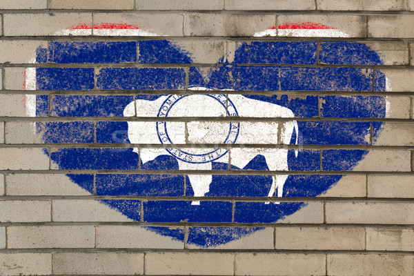 heart shape flag of flag of US state of wyoming on brick wall pa Stock photo © vepar5