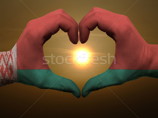 Heart and love gesture by hands colored in belarus flag during b Stock photo © vepar5
