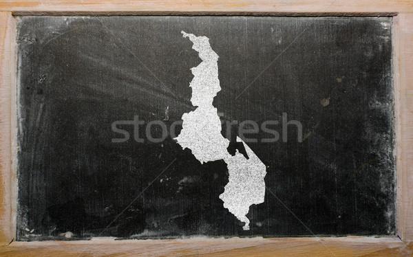 Stock photo: outline map of malawi on blackboard