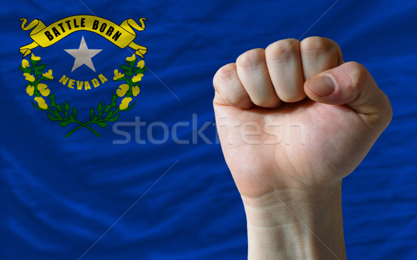 us state flag of nevada with hard fist in front of it symbolizin Stock photo © vepar5