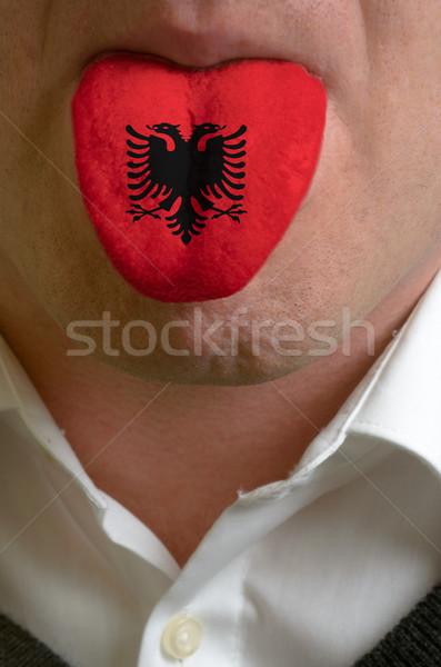 Homem língua pintado Albânia bandeira conhecimento Foto stock © vepar5