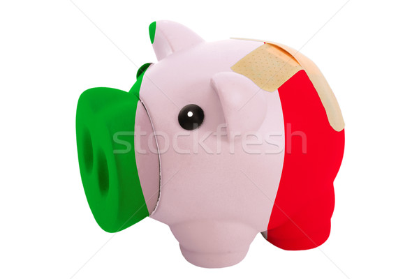 closed piggy rich bank with bandage in colors national flag of i Stock photo © vepar5