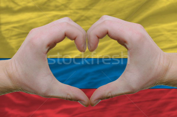 Heart and love gesture showed by hands over flag of columbia bac Stock photo © vepar5