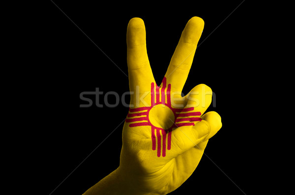 new mexico us state flag two finger up gesture for victory and w Stock photo © vepar5