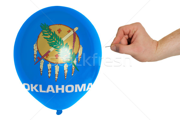 Bursting balloon colored in  flag of american state of oklahoma  Stock photo © vepar5