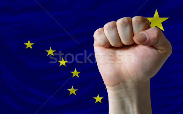 Hard fist in front of us state flag of alaska symbolizing power Stock photo © vepar5