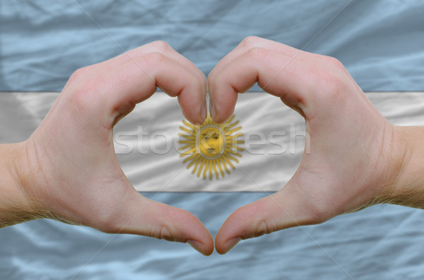 Heart and love gesture showed by hands over flag of Argentina ba Stock photo © vepar5
