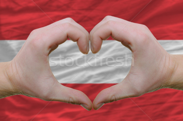 Heart and love gesture showed by hands over flag of Austria back Stock photo © vepar5