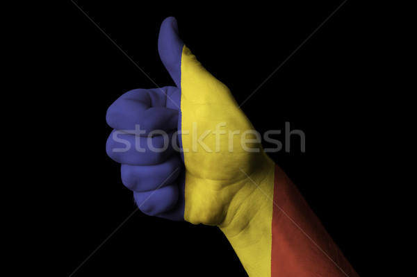 romania national flag thumb up gesture for excellence and achiev Stock photo © vepar5