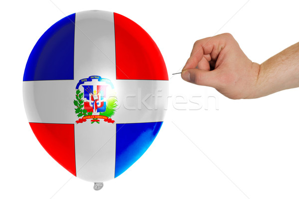 Bursting balloon colored in  national flag of dominican    Stock photo © vepar5