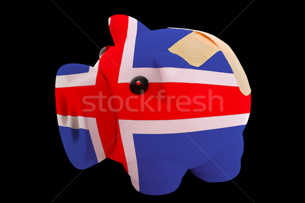bankrupt piggy rich bank in colors of national flag of iceland   Stock photo © vepar5