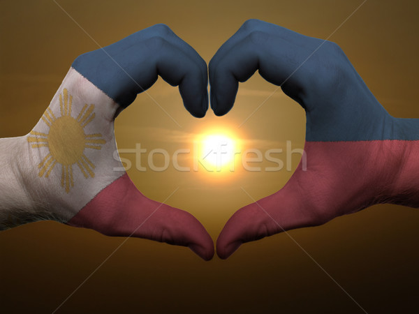 Heart and love gesture by hands colored in phillipines flag duri Stock photo © vepar5