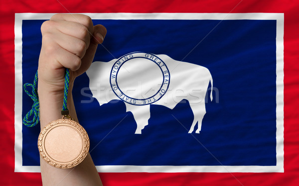 Bronze medal for sport and  flag of american state of wyoming    Stock photo © vepar5