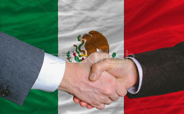 businessmen handshake after good deal in front of mexico flag Stock photo © vepar5