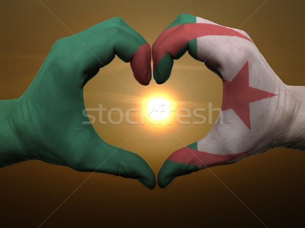 Heart and love gesture by hands colored in algeria flag during b Stock photo © vepar5