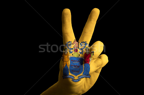 new jersey us state flag two finger up gesture for victory and w Stock photo © vepar5