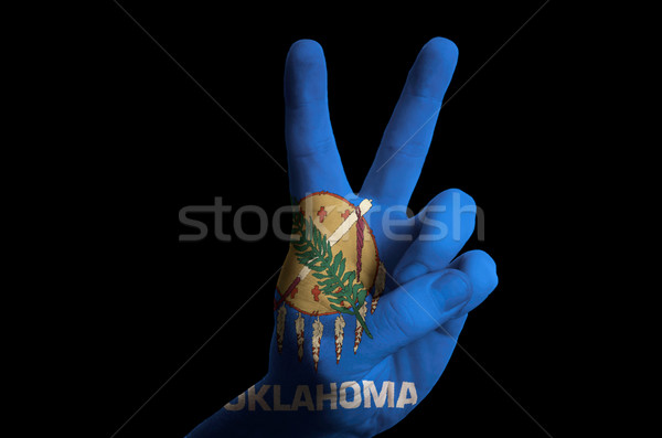 oklahoma us state flag two finger up gesture for victory and win Stock photo © vepar5