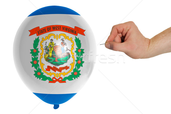 Bursting balloon colored in  flag of american state of west virg Stock photo © vepar5