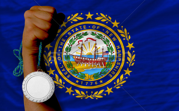 Silver medal for sport and  flag of american state of new hampsh Stock photo © vepar5