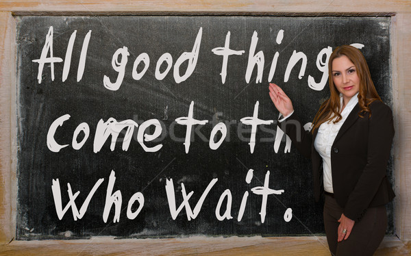 Teacher showing All good things come to those who wait on blackb Stock photo © vepar5