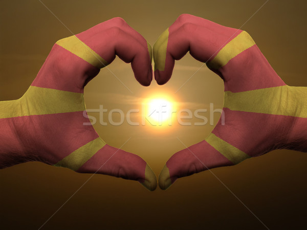 Heart and love gesture by hands colored in macedonia flag during Stock photo © vepar5