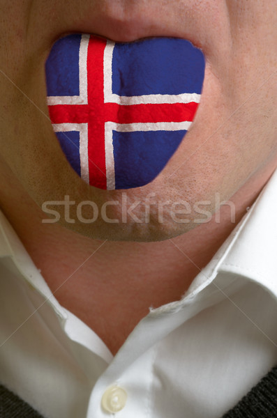 man tongue painted in iceland flag symbolizing to knowledge to s Stock photo © vepar5