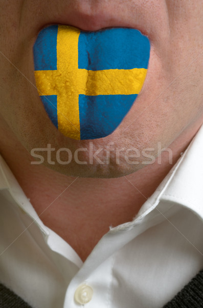man tongue painted in sweden flag symbolizing to knowledge to sp Stock photo © vepar5