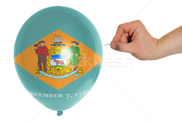 Bursting balloon colored in  flag of american state of delaware  Stock photo © vepar5