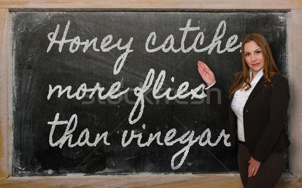 Leraar tonen honing meer azijn geslaagd Stockfoto © vepar5
