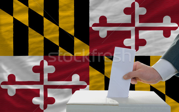 man voting on elections in front of flag US state flag of maryla Stock photo © vepar5
