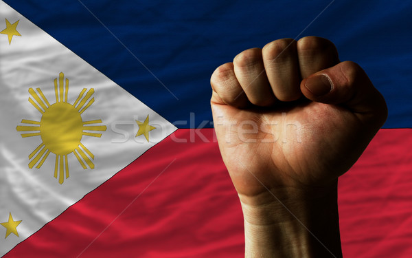 Hard fist in front of philippines flag symbolizing power Stock photo © vepar5