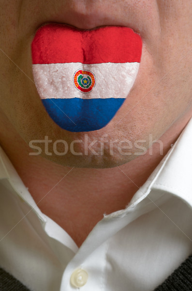 man tongue painted in paraguay flag symbolizing to knowledge to  Stock photo © vepar5